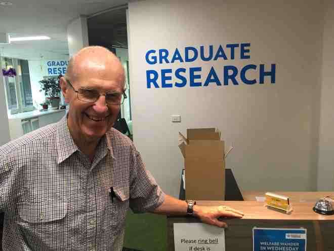 Robin at the Graduate Office at UC handing in his thesis