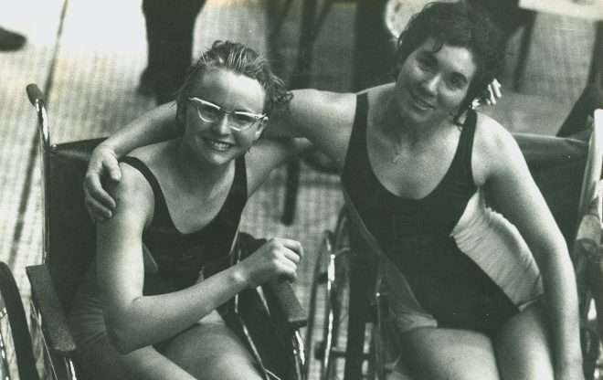 A picture of two Paralympic swimmers from 1964