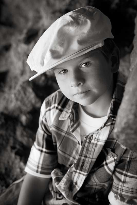 boy with hat in black and white