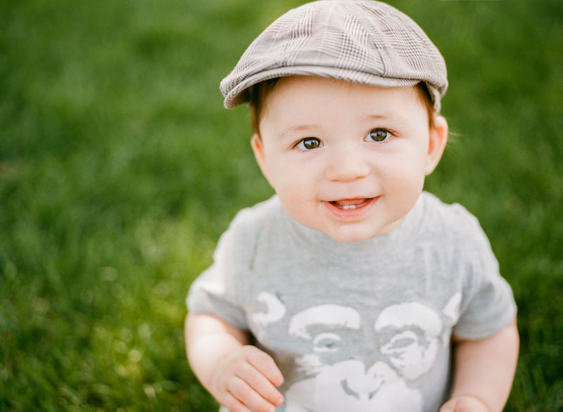 Baby in grass by Dallas/Fort Worth film wedding photographer