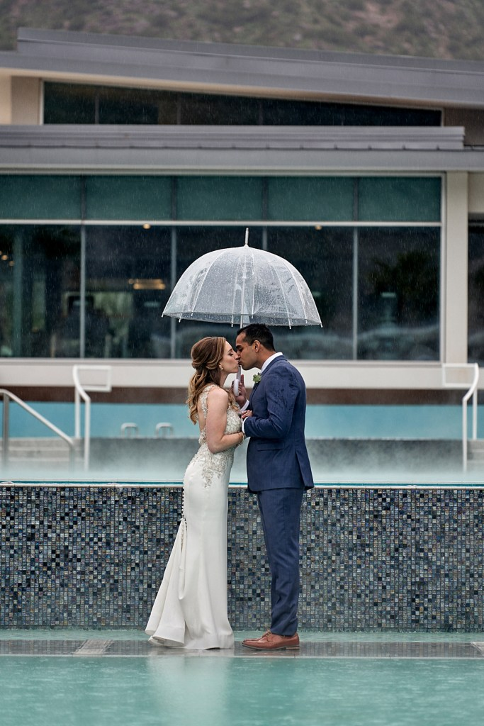 first look on a rainy day with umbrellas by pool