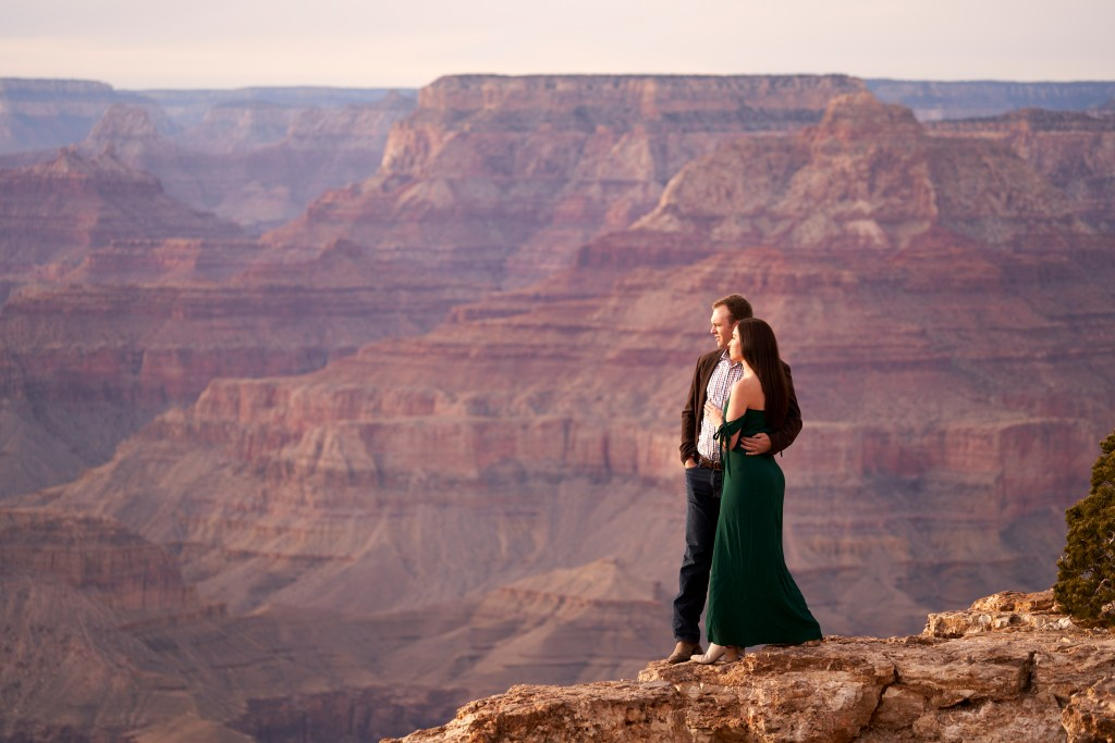 couple on the edge of the grand canyon