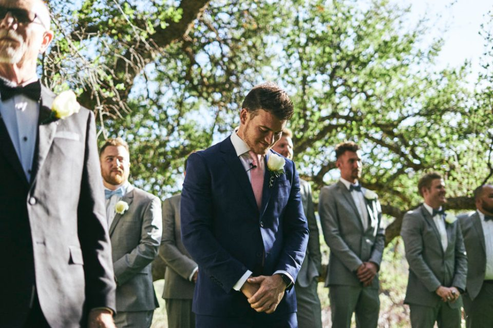 groom crying as bride walks down the aisle in prescott
