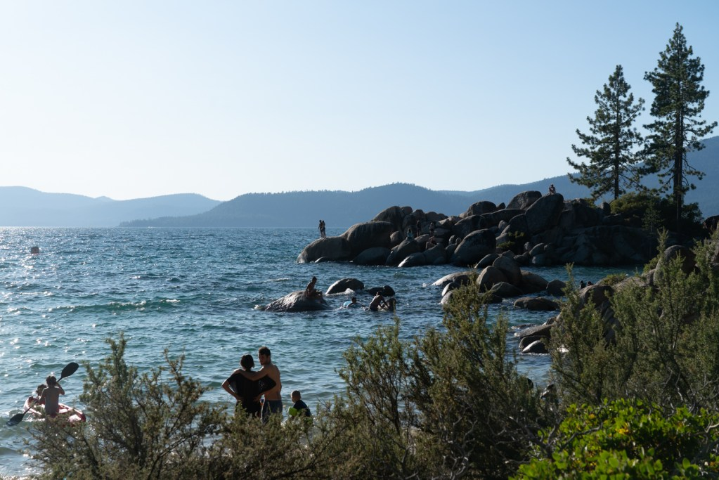 Kids jumping off of rocks in Lake Tahoe