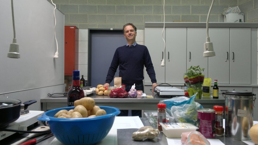 Keith standing behind cooking stations