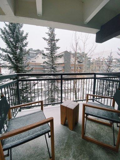Balcony view of snow and trees at the Vail Marriott Mountain Resort in Lionshead during our Vail Ski Trip