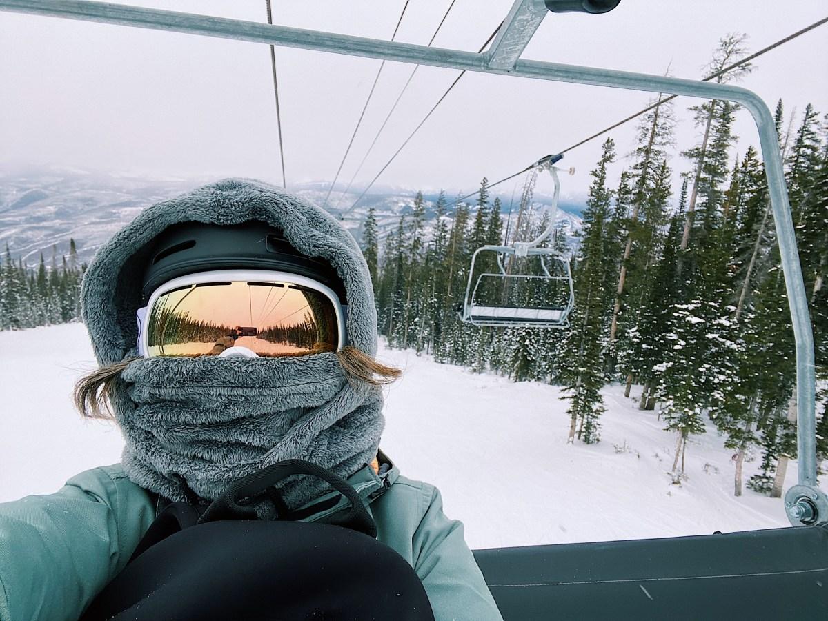 snowboarder on a ski lift in Beaver Creek Ski Resort Colorado