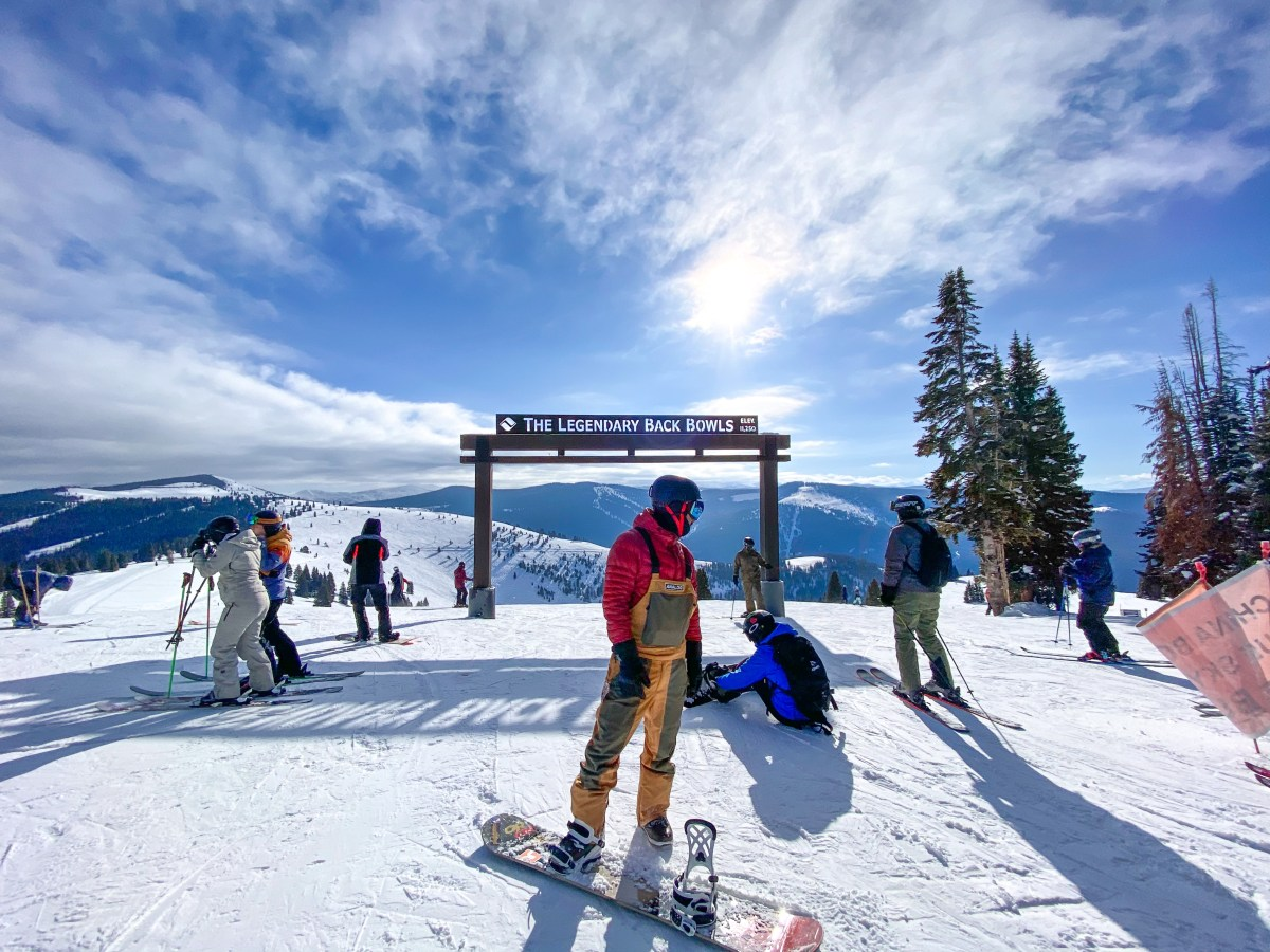 snowboarder at the back bowls in Vail Ski Resort Colorado