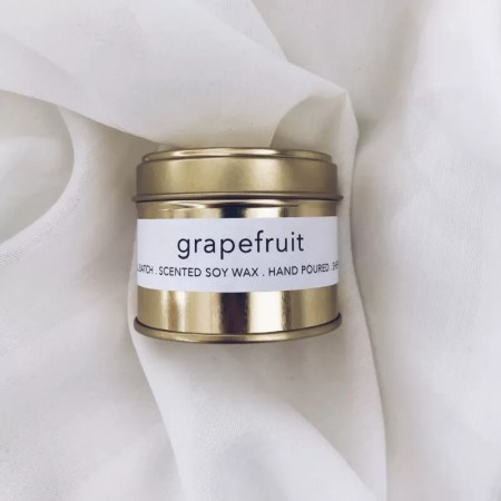 Grapefruit scented soy wax candle tin with Kelham Candle Co hand made in Sheffield label