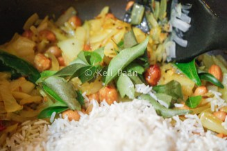 Add curry leaves and rice
