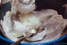 Strain the sweetened yogurt using a sieve..