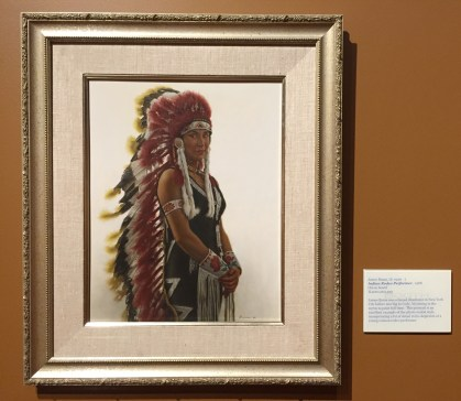 James Bama, 'Indian rodeo performer', 1988, oil on board, at Booth Western Art Museum, Cartersville, GA. Photo credit Kelise Franclemont. The card reads: 'James Bama was a famed illustrator in New York City before moving to Cody, Wyoming in the 70s to paint full-time. This portrait is an excellent example of the photo-realist style, incorporating a lot of detail in his depiction of a young woman rodeo performer.'