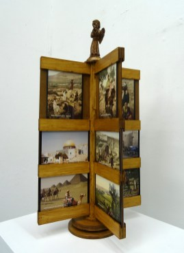 Kelise Franclemont, 'Postcards from the Land of No People (wish you were here)', 2015, postcard prints in a wooden rack. Image courtesy the artist.