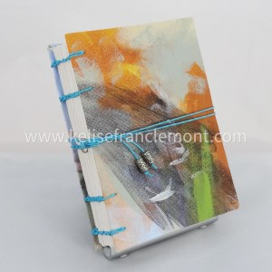 handsewn journal, exposed binding, cover is abstract, orange, green, teal; turquoise cord closure with beads