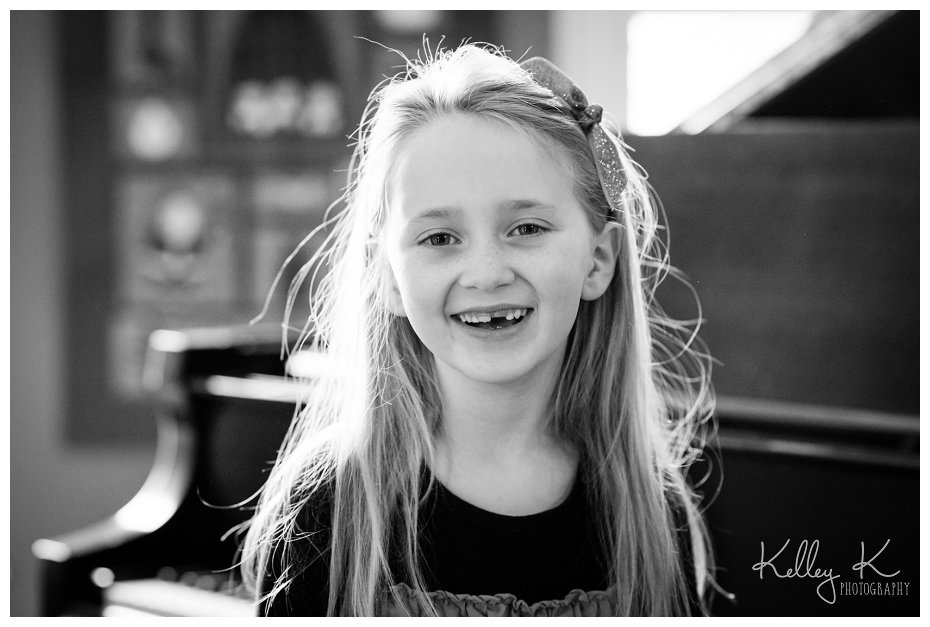 Child in front of piano | Kelley K Photography - Smyrna