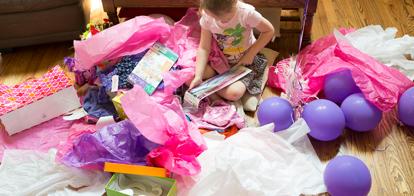 Birthday girl opening gifts | Kelley K Photography