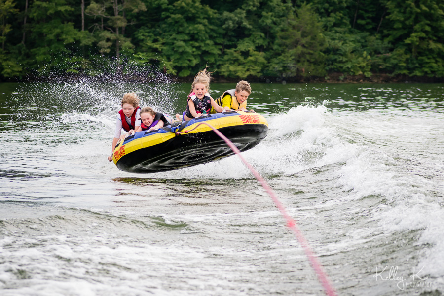 Kids-tubing-getting-air-KelleyKPhotography-SmyrnaGA