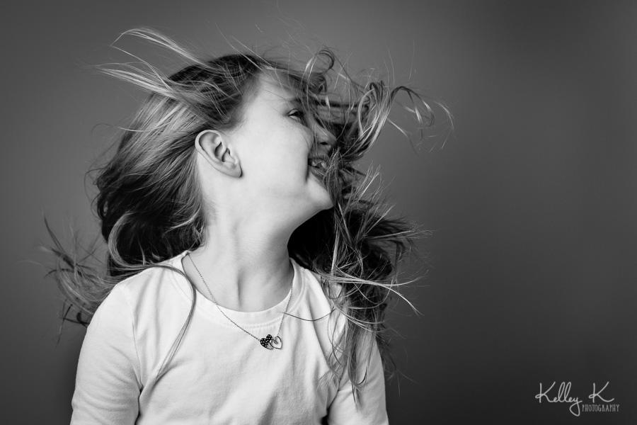 Girl-hair-blowing-studio-black-white-KelleyKPhotography-SmyrnaGA