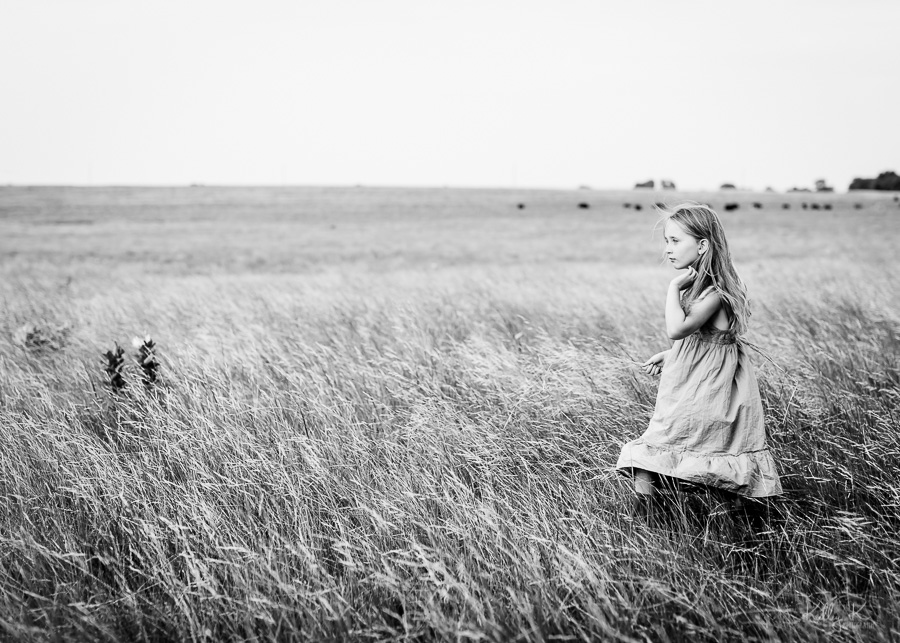 Timeless black and white image of a girl in a field of grain