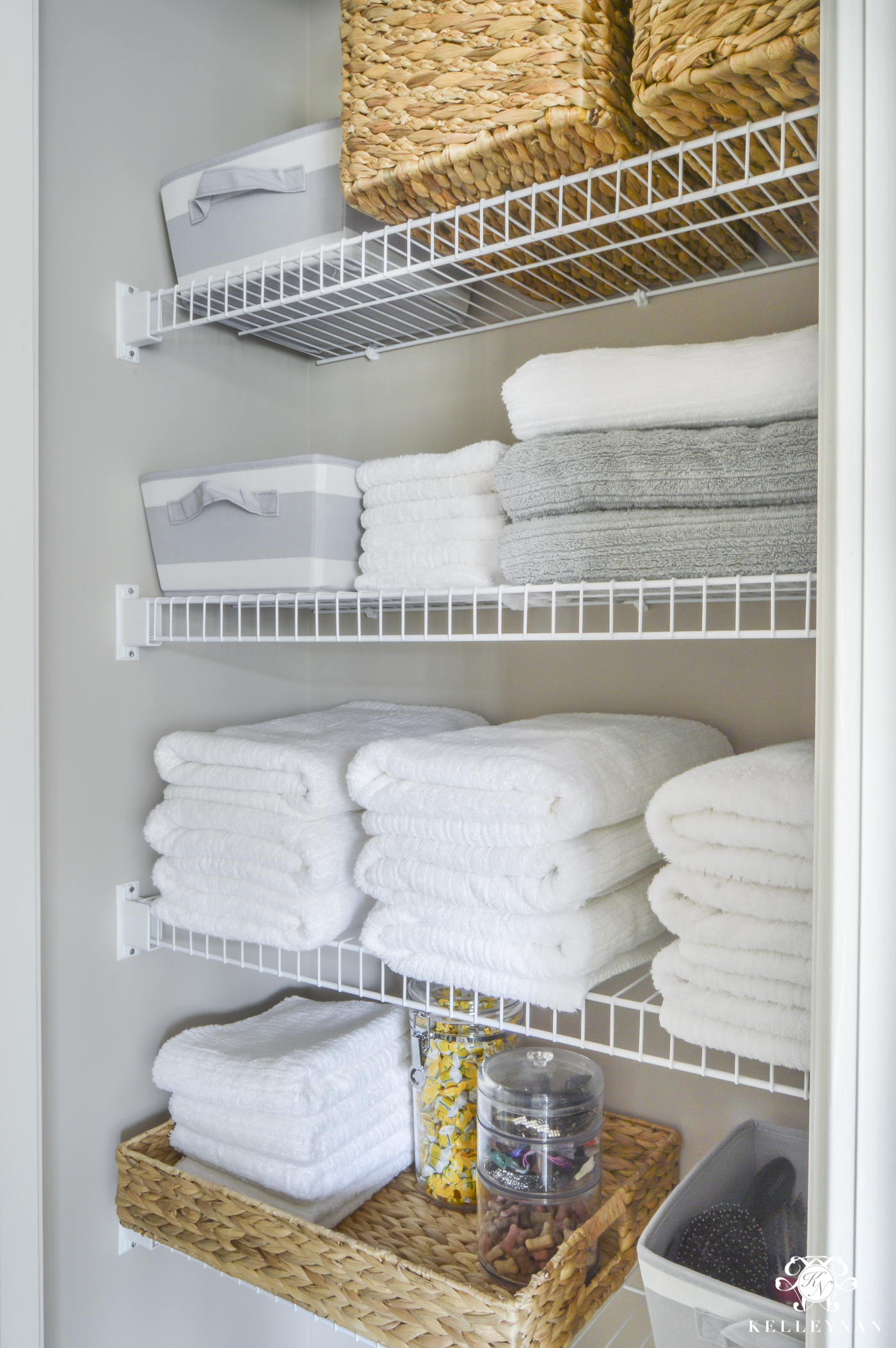 organized bathroom linen closet anyone can have - kelley nan
