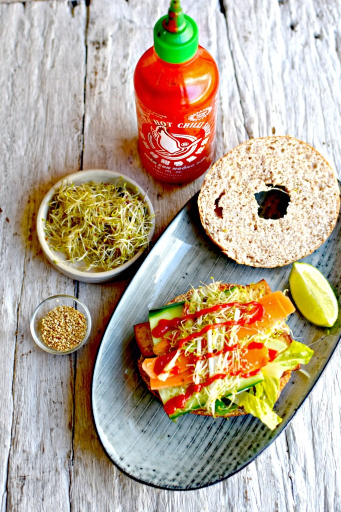 bang bang tofu bagel with sriracha-lime peanut butter, avocado and thinly shredded vegetables // food to glow