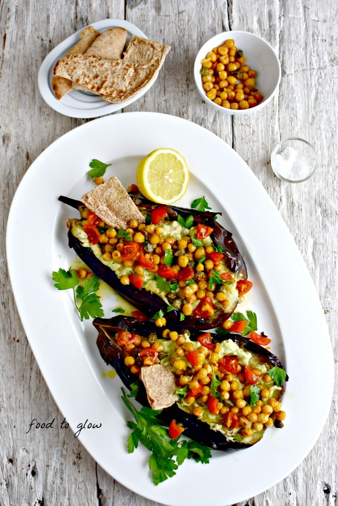 Meltingly soft fire-roasted eggplant plus creamy avocado sauce and salty, citrus-spiked capers and chickpeas make this as much a meal as an impressive appetizer or dip.