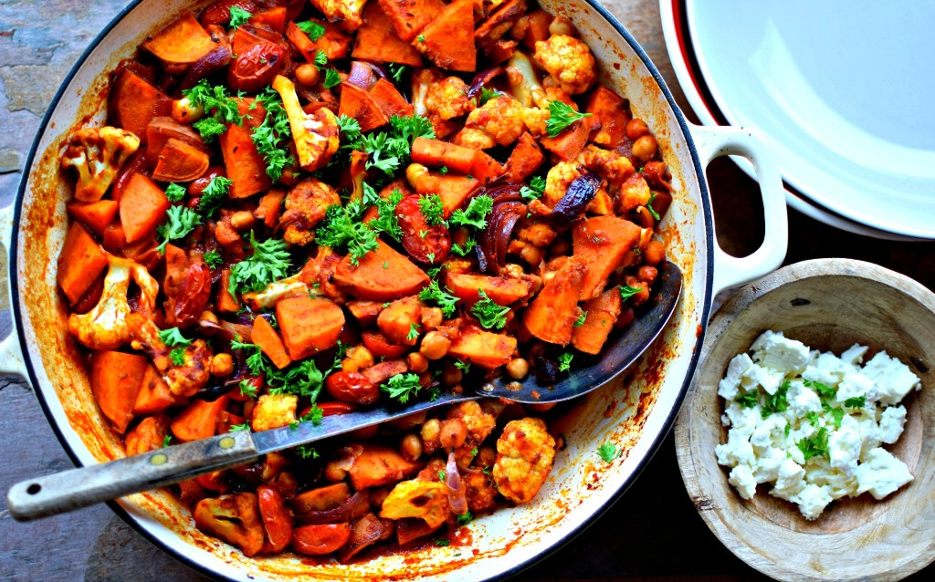 Super-easy and full of warm spices, this hearty, fibre-rich dish is perfect for autumn evenings. We enjoy this with wholegrain couscous, but equally quinoa, brown basmati rice, some flatbreads for scooping, or even baked potatoes would be a great accompaniment to this colour- and flavour-packed family-minded dish. Serve with a crisp green salad or wilted greens studded with raisins and pine nuts.