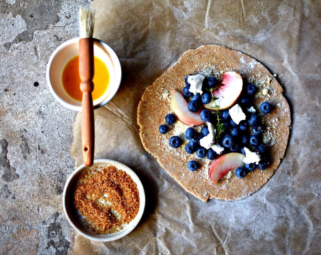 Process image: This easy to make, light as a feather spelt pie crust dough is the perfect beginner's baking recipe. Filled with blueberries, peaches and complementing goat's cheese make it sophisticated enough for company too.