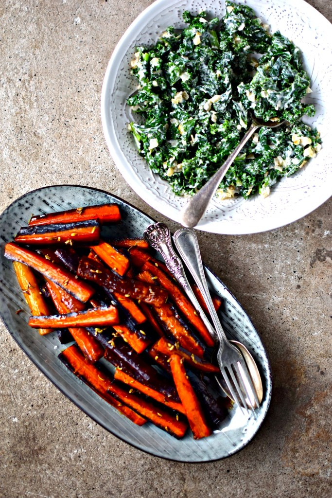 Holiday side dishes are sorted with these easily made fennel and maple roasted carrots and creamed kale (vegan option too). Both can be prepared ahead and reheated when you need them. Super for Thanksgiving, Chrisstmas or any autumn/winter meal.