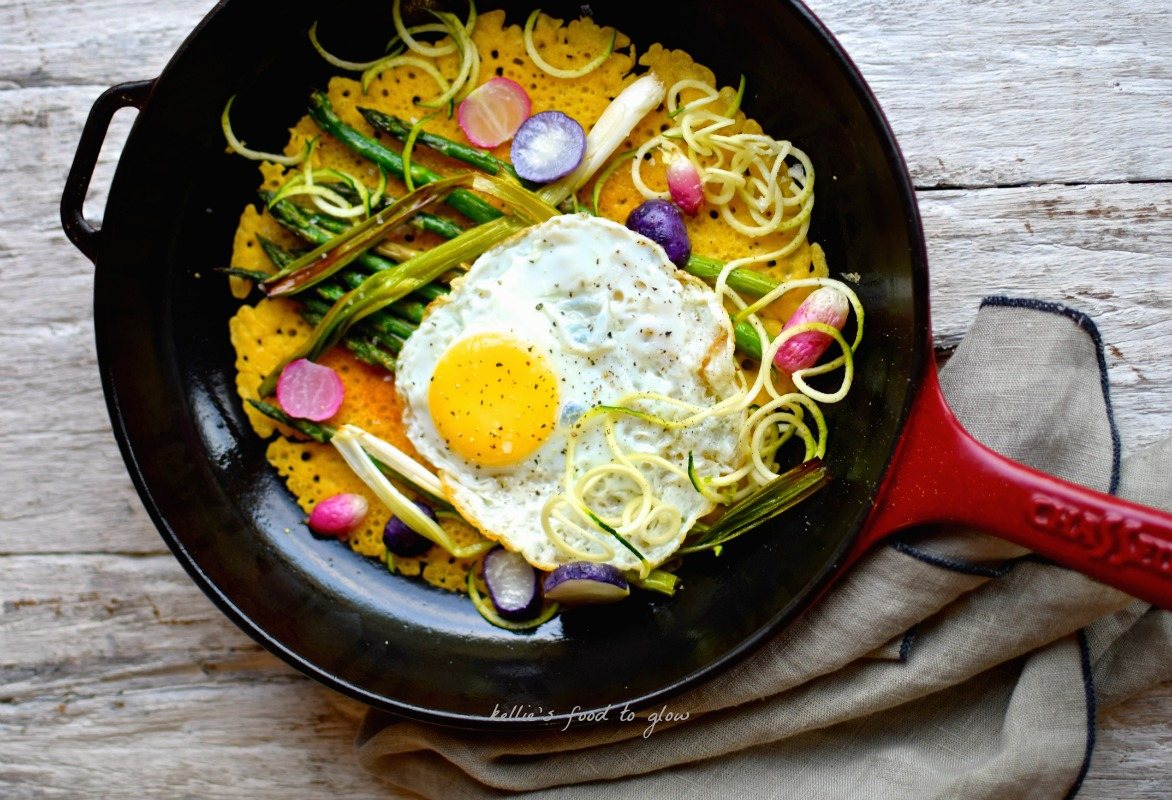 Lazy Sunday brunch with naturally gluten-free lacy-edged chickpea flour pancakes, topped with roasted spring vegetables, zoodles & a steam-fried egg. Skillet cooking made healthy!