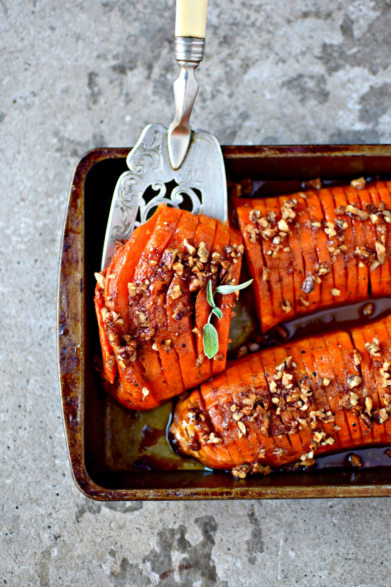Take the hassle out of hasselback with my easy way of making this cute Thanksgiving or Christmas side dish. Normally seen on white potatoes, hasselback is also the perfect way to spruce up sweet potatoes or butternut squash. By part-baking before slicing and slicking with the flavourings, you save your fingers and your sanity. Top tip!
