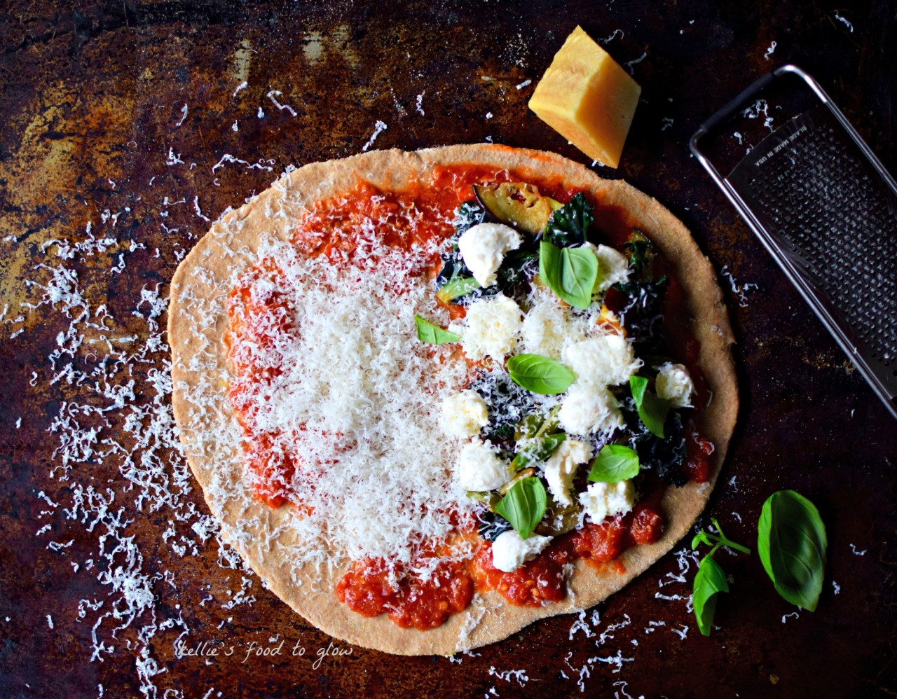 We all know that homemade is better than takeaway, especially when it comes to pizza. Make your family happy by making this easy, food processor-kneaded wholewheat dough, and topping with slivers of long-stemmed broccoli, sauteed eggplant and kalette, all over a quick raw tomato sauce. Family-friendly vegan or vegetarian healthy eating. This also makes brilliant calzones too.