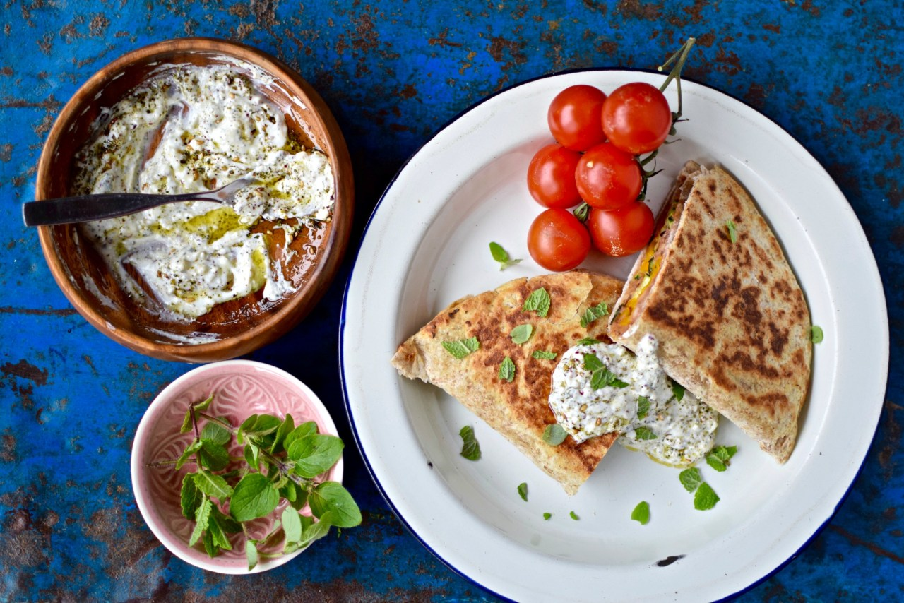 Crispy, delicious and vegan, this chipotle refried bean and herb quesadilla with za'atar yogurt sauce is perfect for lunch or a light dinner. Sauteed and lemony seasonal vegetables add extra flavour and nutrition. Serve with green salad and your favorite hot sauce. The recipe is easily doubled for a healthy family meal.