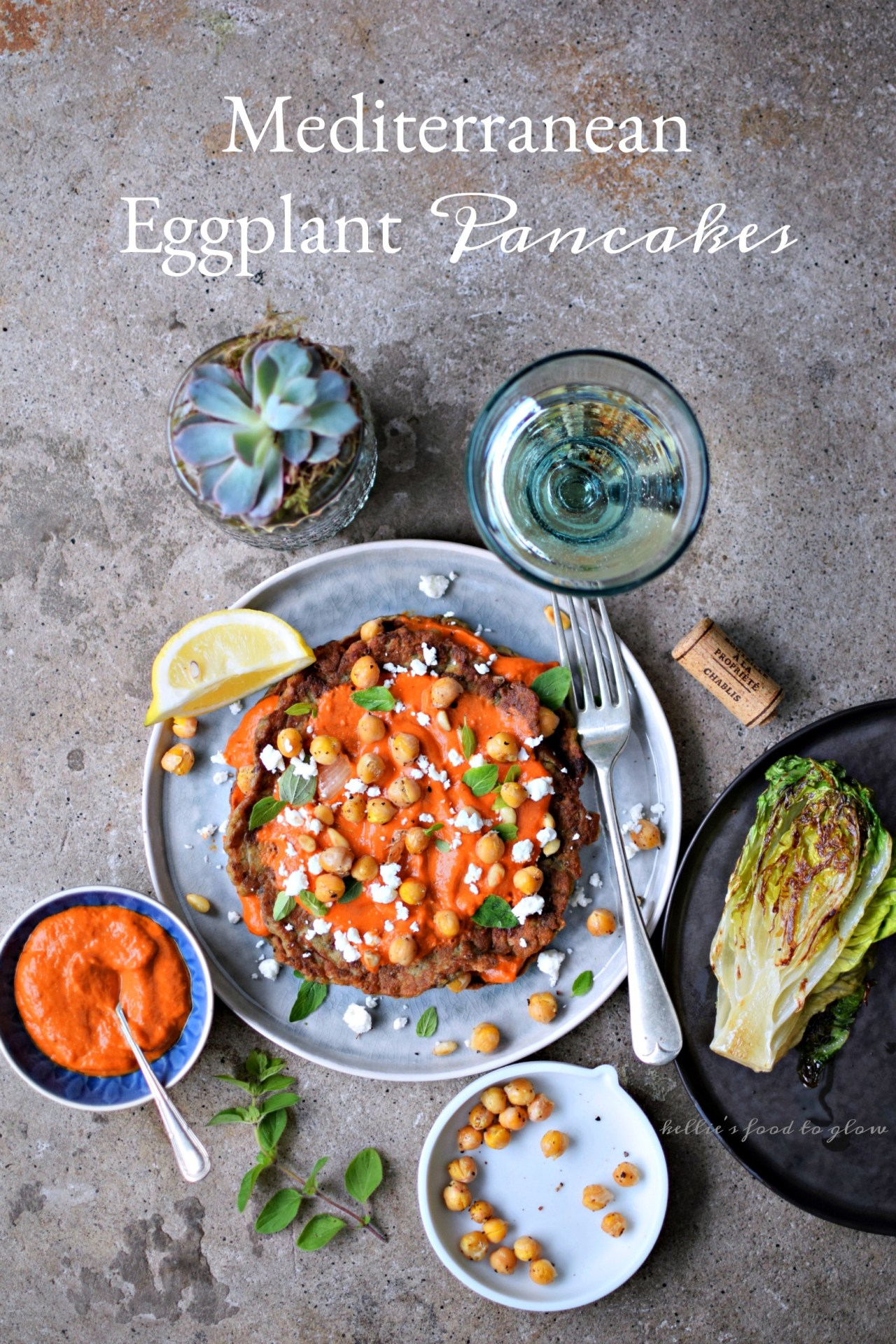 Soft savory pancakes of roasted aubergine, onion marmalade and summer herbs, barely held together with a whisper of flour and eggs, and served with a smear of sweet red pepper sauce. Make-ahead steps and a do-everything sauce = easy summer lunches and appetizers.