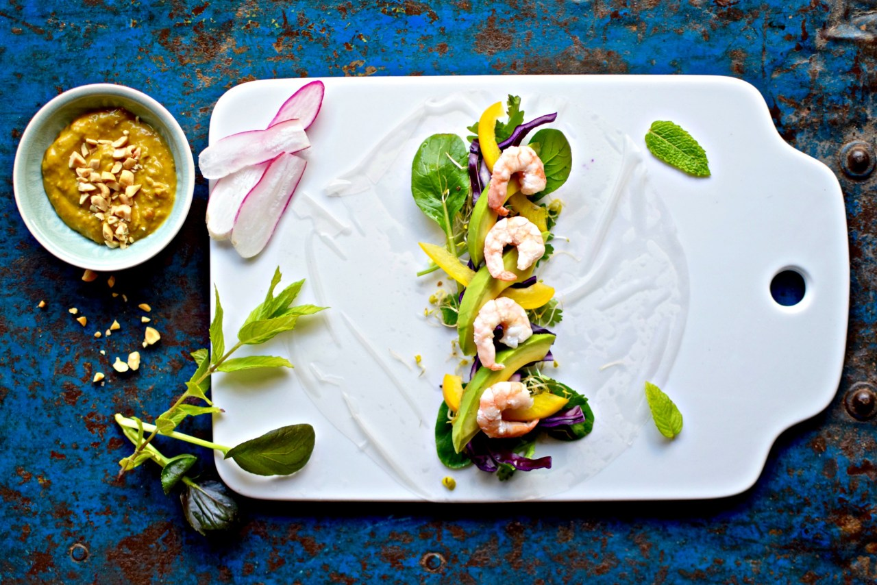 Lower carb avocado, rainbow vegetable and prawn-filled Vietnamese summer rolls are perfect dipped into silky peanut-tamarind dip. An easy, healthy appetizer, starter or light supper. Swap prawns for marinated tofu for a vegan option.