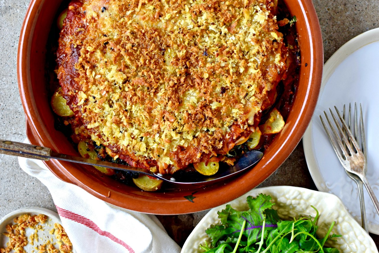A delicious late-summer jackpot of a recipe, done alla parmigiana. Not just eggplants, but chard, potatoes, garlicky oil and a simple homemade sauce, layered up and covered in gooey cheese and earthy porcini breadcrumbs. Hearty yet light; a vegetarian recipe the whole family will love.