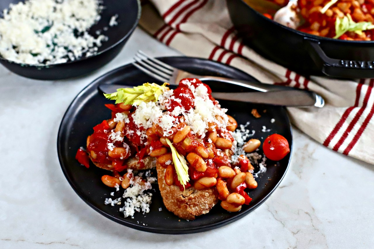 Deliciously frugal Bloody Mary Baked Beans on toast make a great breakfast, brunch, lunch or dinner, especially with a golden-yokedpoached egg on top.