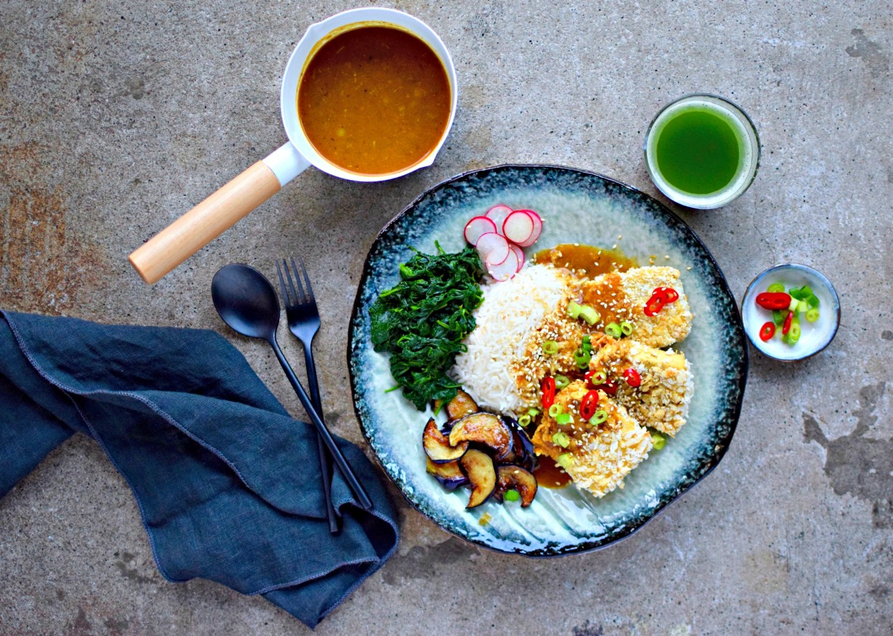 Usually  a chicken dish, this baked not-fried panko-crusted tofu sits atop homemade, aromatic Japanese katsu curry sauce for a lunch or dinner to please and delight vegetarians, vegans and meat-lovers alike. A silky side of miso aubergine slivers and yuzu-splashed spinach round out this palate-pleasing recipe.