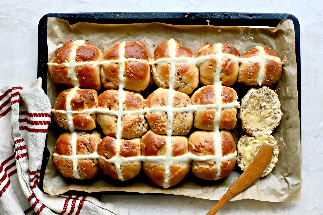 A gently savory yeasted and seeded bun for slathering in butter and using as rolls for mini sandwiches. These are lovely spread with a little soft cream cheese and topped with thinly sliced cucumber. An Easter-time treat. #hotcrossbun #savory #baking #bread #Easterrecipe