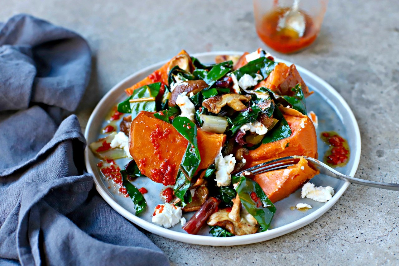 A quick and nutritious sweet potato meal for one, with stir-fried greens and mushrooms and topped with an easy homemade piri piri sauce. Easily doubled etc. #vegetarian #healthyrecipe #quickandeasy #sweetpotato #food #easilyvegan