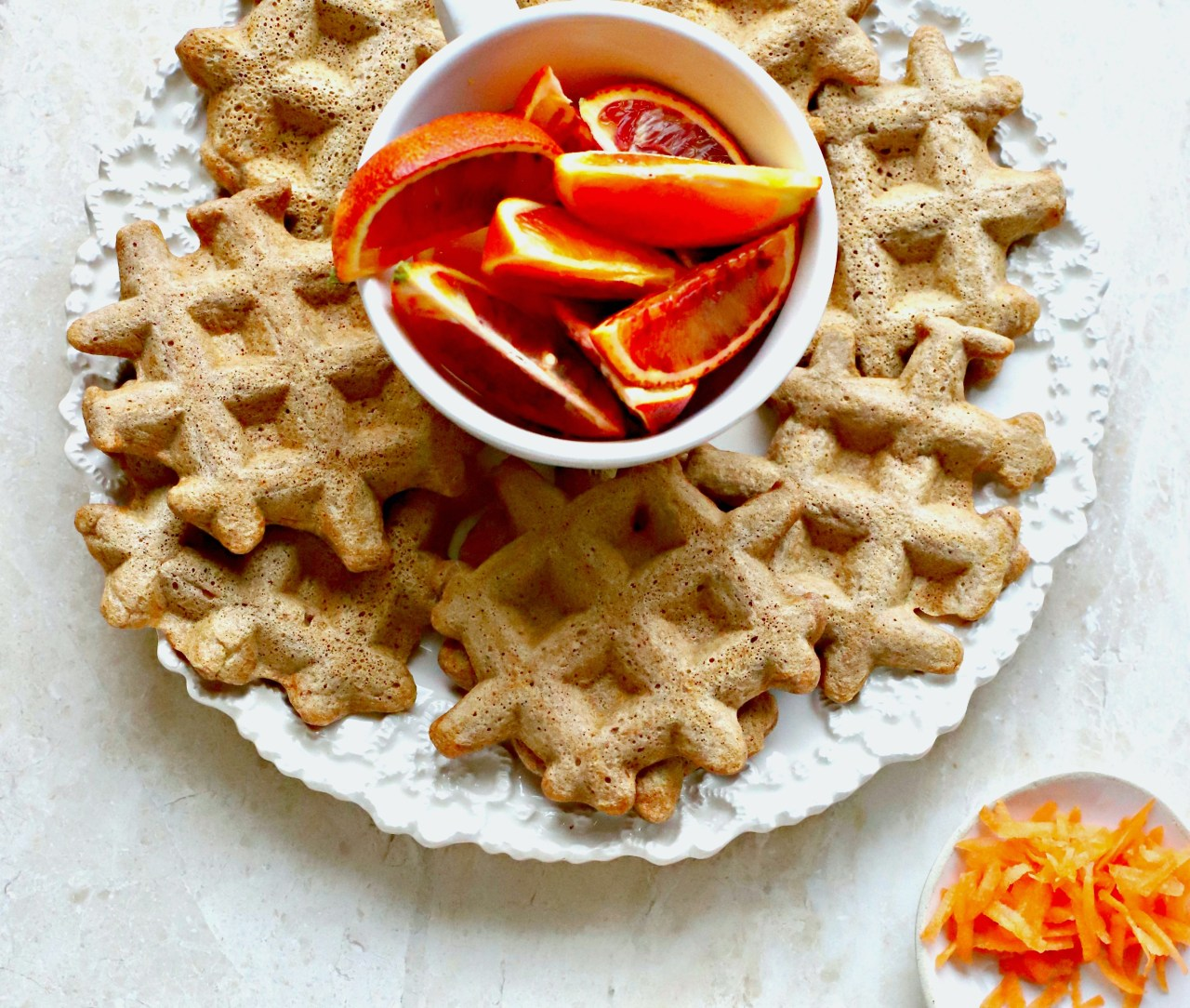 Homemade carrot cake waffles for weekend making and weekday toasting. Drizzle over brown butter and cardamom syrup for an easy touch of luxury. #waffles #carrots #breakfast #easyrecipe #wholegrain
