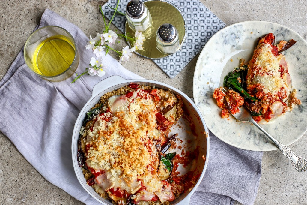 Layers of chard, quinoa, grilled eggplant, marinara sauce and optional cheese equals easy, nutritious, autumn #comfortfood #healthyrecipe #vegetarian #oliveoil #casserole #quinoa