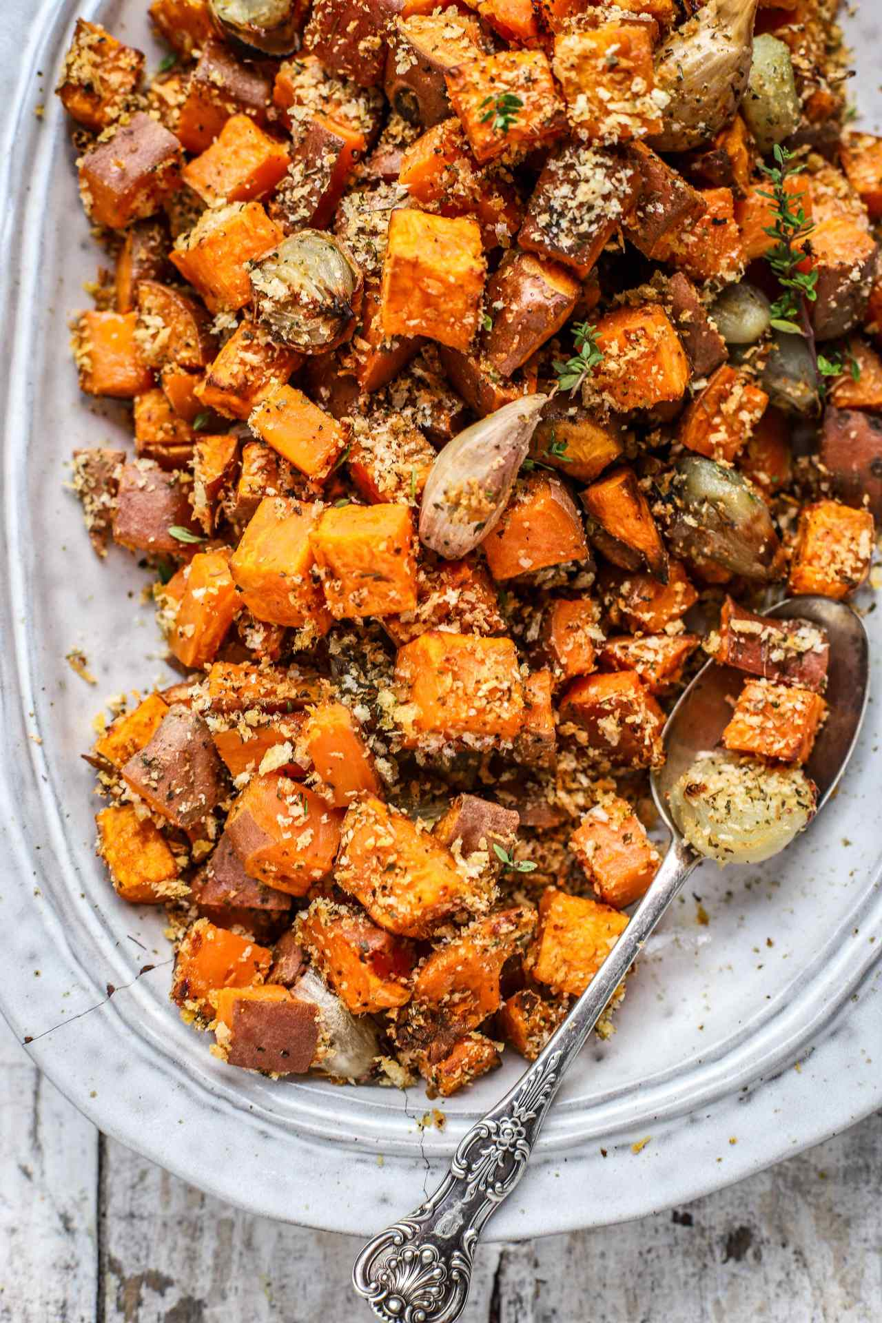 Roasted Parmigiano Reggiano Sweet Potatoes and Shallots are a super-simple sweet, savoury, crunchy, and soft nutritious side dish that will have your family asking for seconds. These would be great for any dinner - festive or everyday. #sidedish #sweetpotatoes #parmesan #easyrecipe #family #food