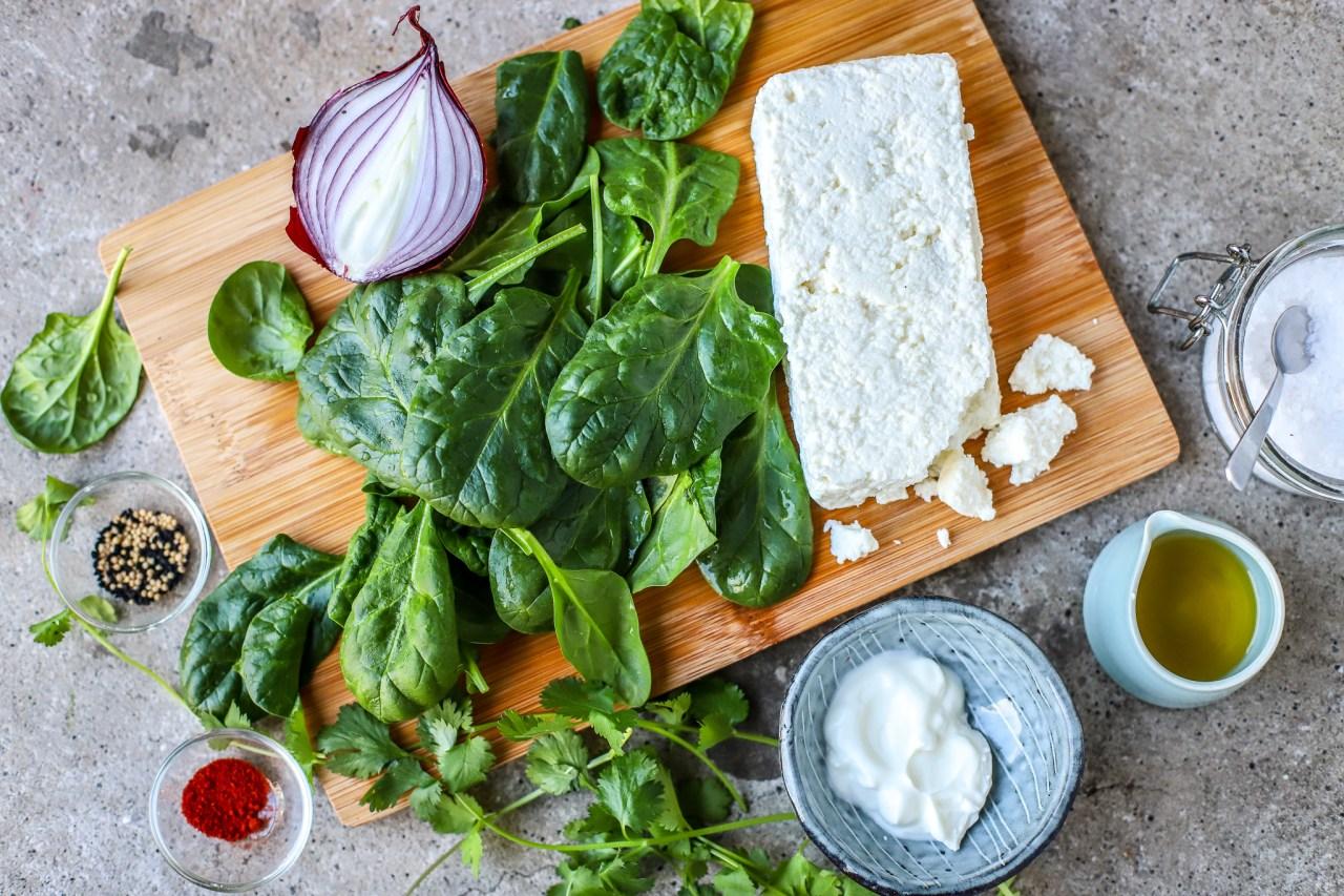saag paneer grilled cheese ingredients on wooden board