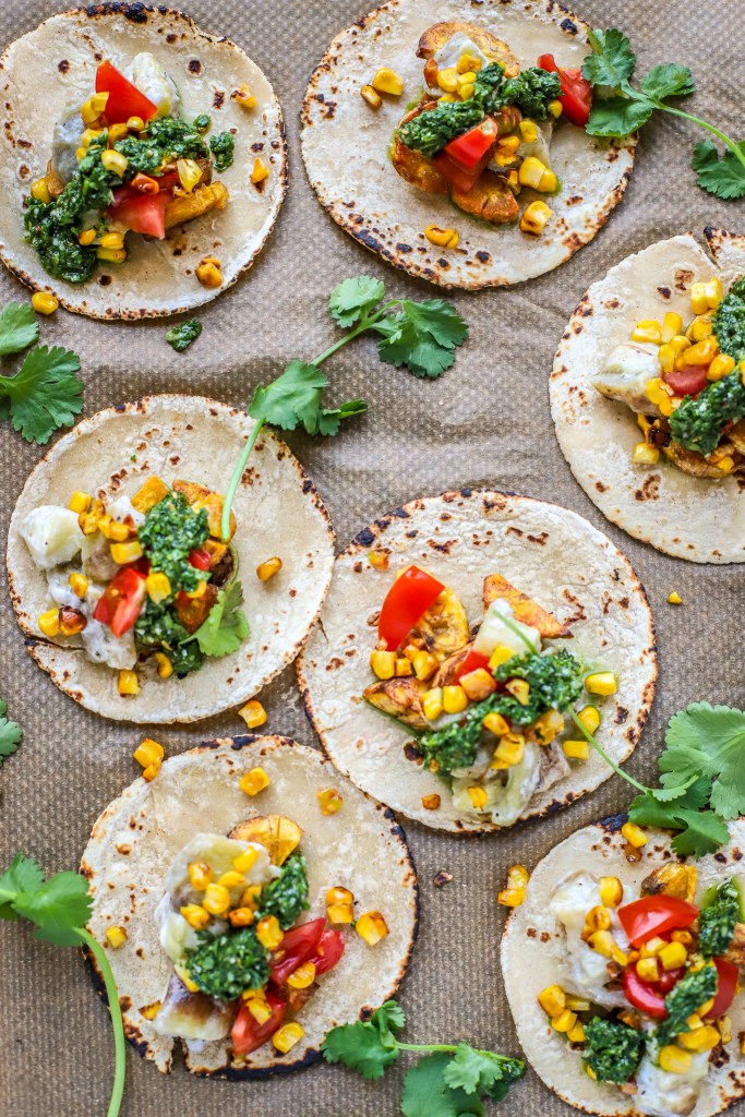 Vertical flatlay of plantain and summer vegetable tacos