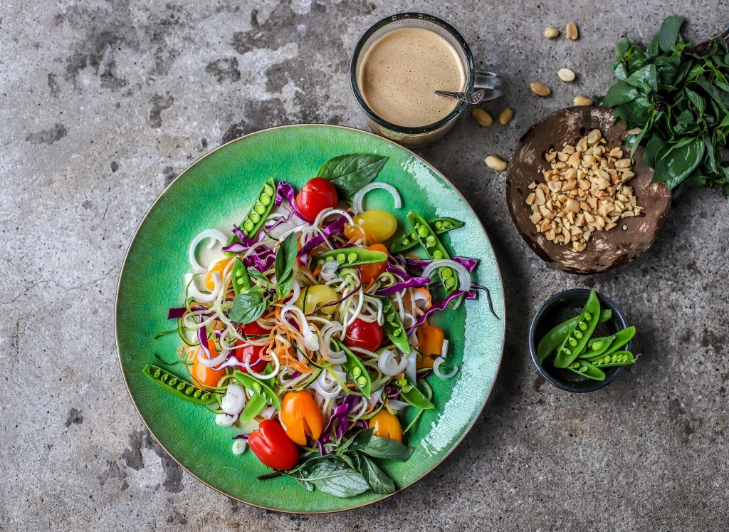 building the Thai Rainbow Noodle Salad with peanut dressing and herbs