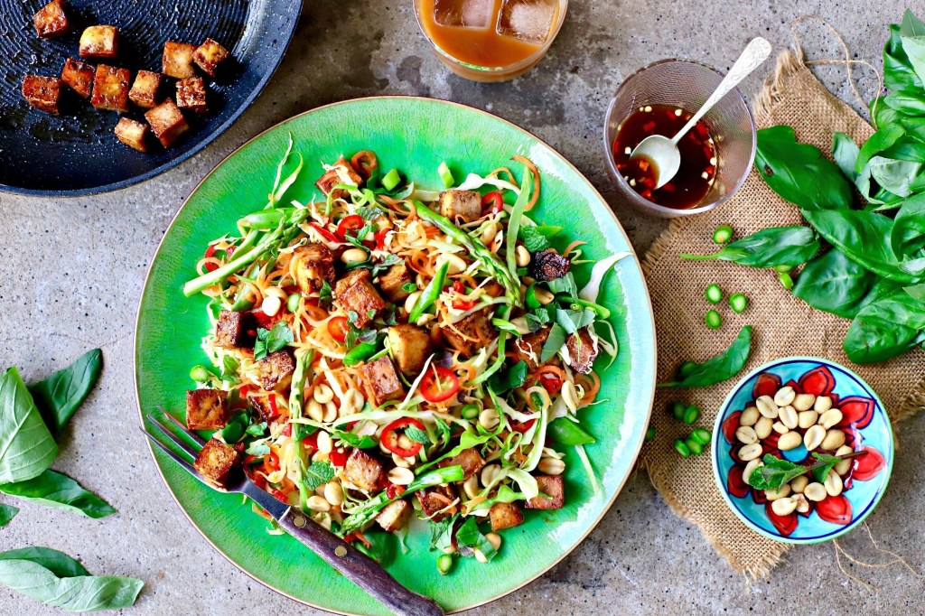 Vietnamese tofu salad with all the garnishes surrounding it