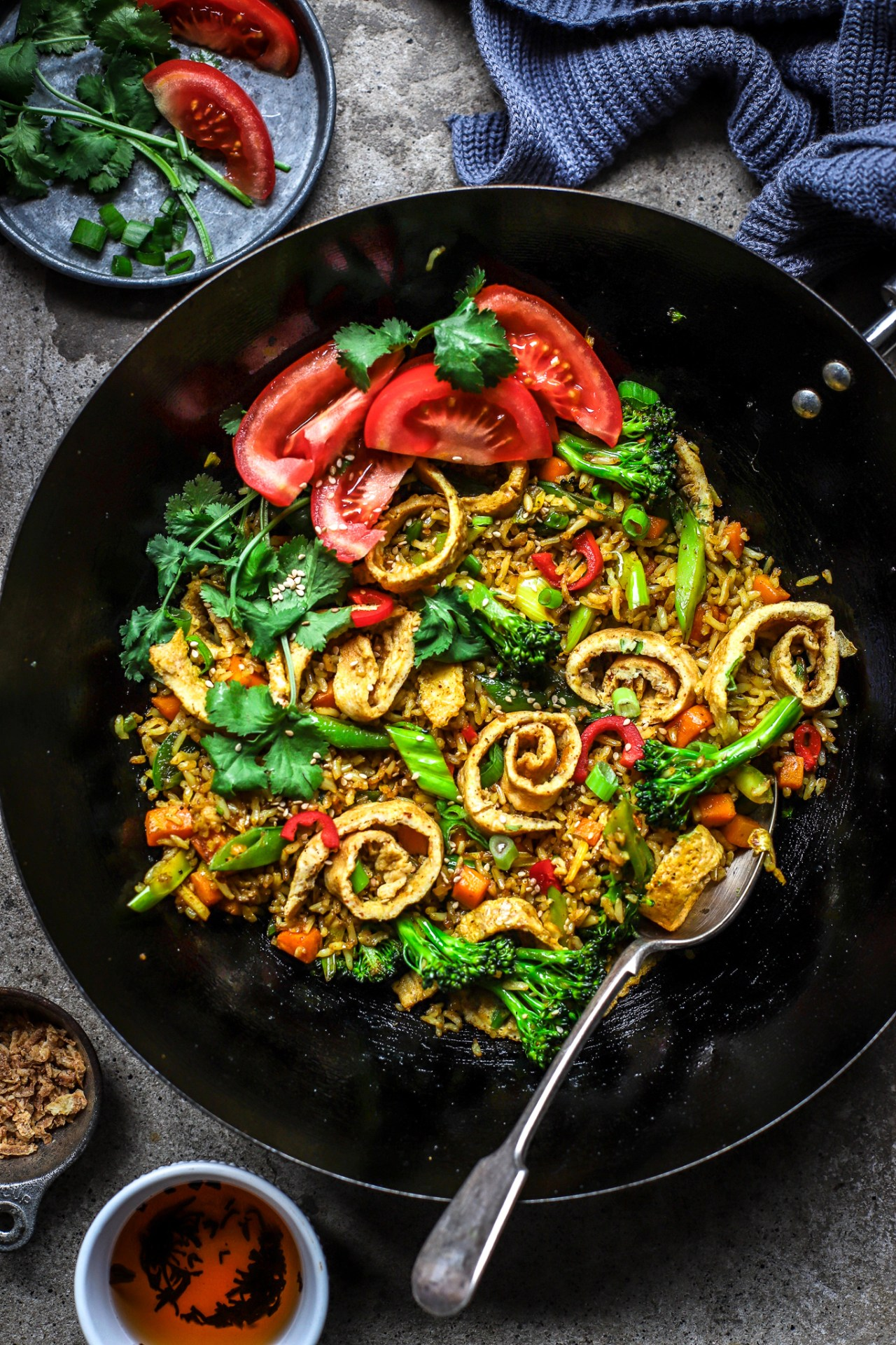 Chinese turmeric fried rice in wok with vintage spoon