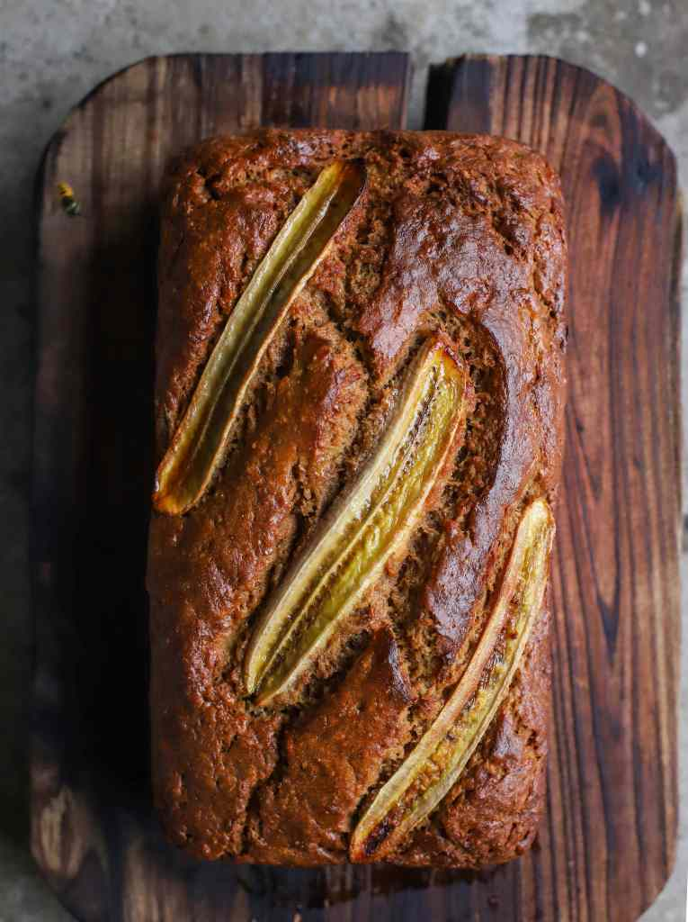 close up brown butter banana bread on wooden board