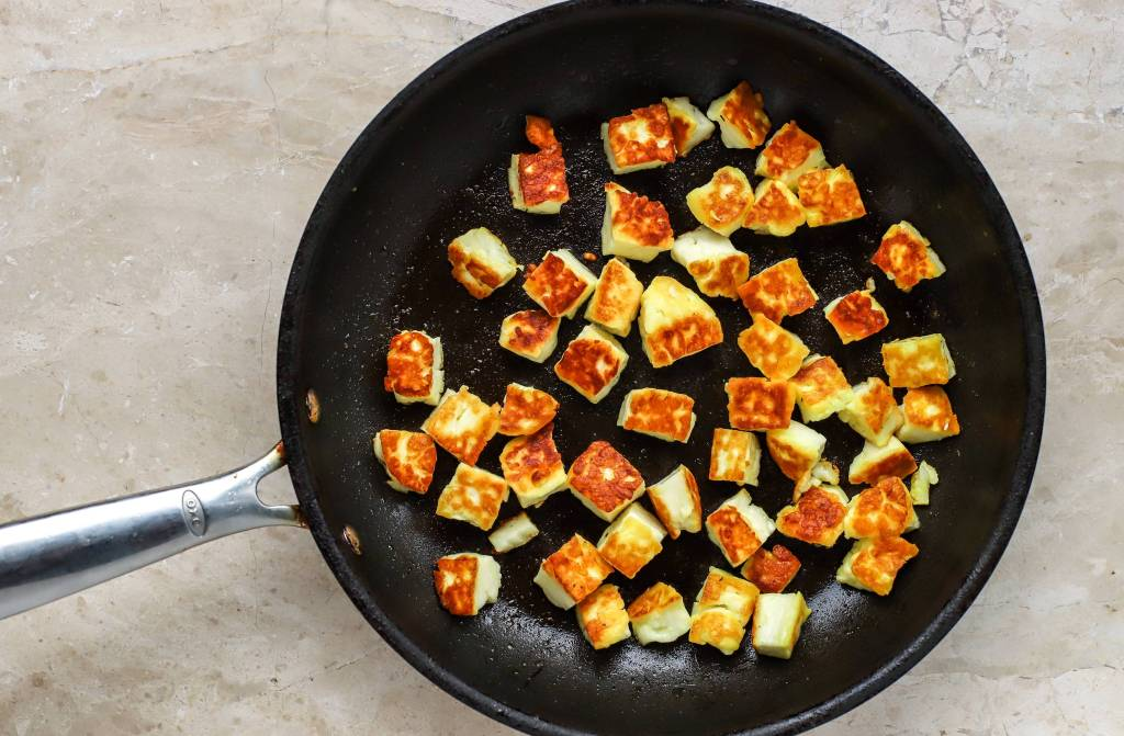 frying halloumi in skillet